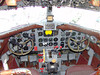 "By comparison, here is the cockpit of a DC3. Besides the old ""steam gauges"", look at all the knobs and buttons overhead."