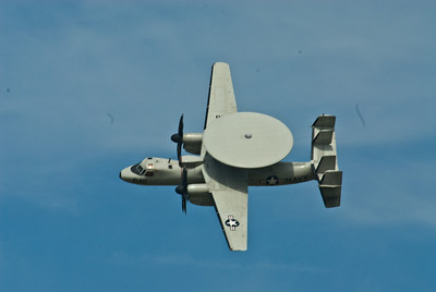 E2-C Hawkeye.  Note the distinct 4 tail assembly along with the Radome