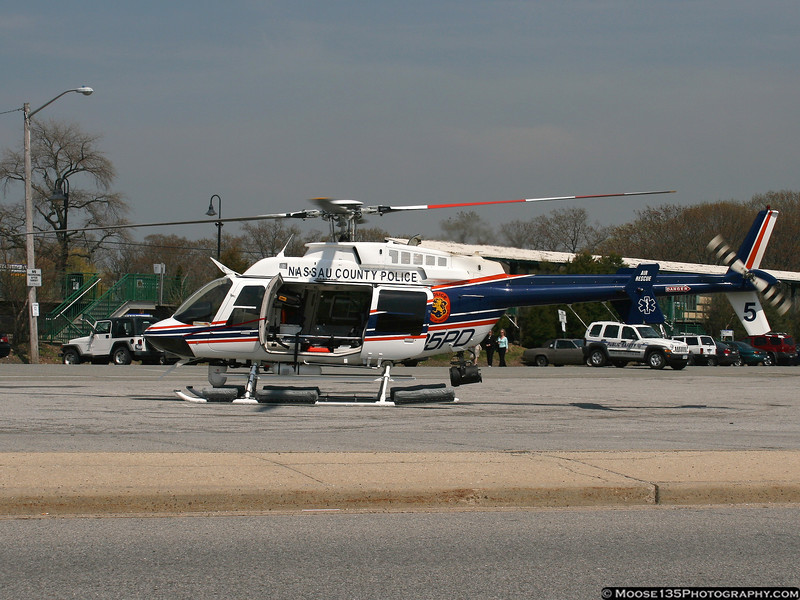 "NCPD's newest helicopter, ""Nassau 5"" waiting for the arrival of a patient at the Oyster Bay LIRR station parking lot on a Medevac mission."