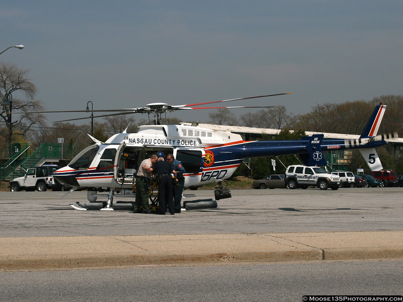 "NCPD's newest helicopter, ""Nassau 5"" receiving a patient at the Oyster Bay LIRR station parking lot on a Medevac mission."