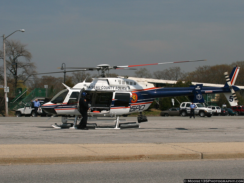 "NCPD's newest helicopter, ""Nassau 5"" at the Oyster Bay LIRR station parking lot on a Medevac mission."