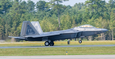 F-22 Raptor from First Fighter Wing based in Langley, VA rotates on Runway 5R-23L