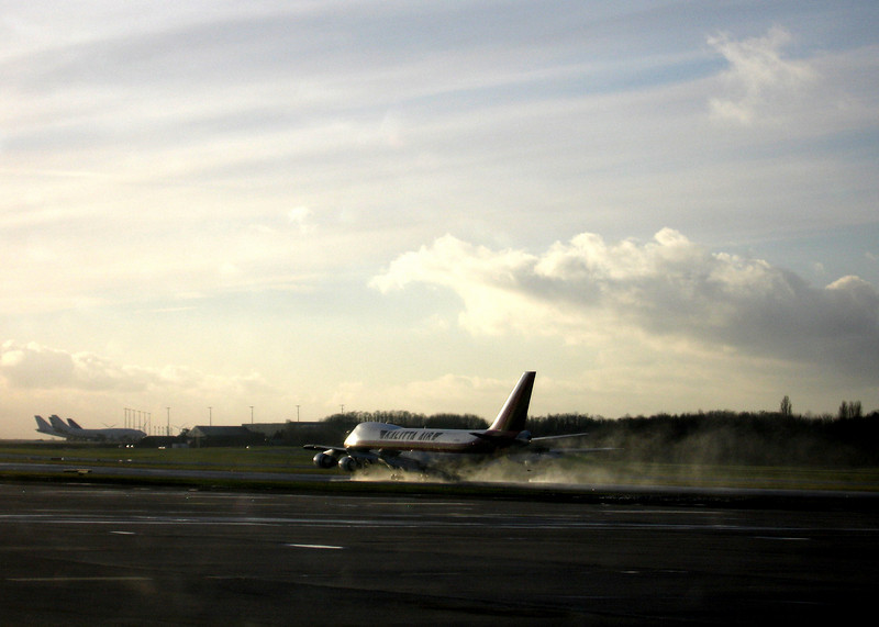Touchdown, spoilers, reversers, water spray. Check.
