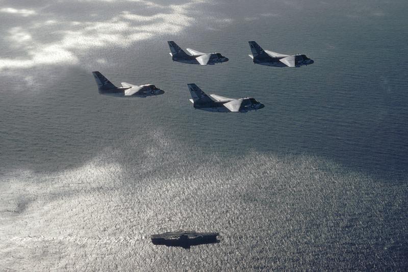 4 S-3 Vikings of VS-22 over the USS Saratoga CV60