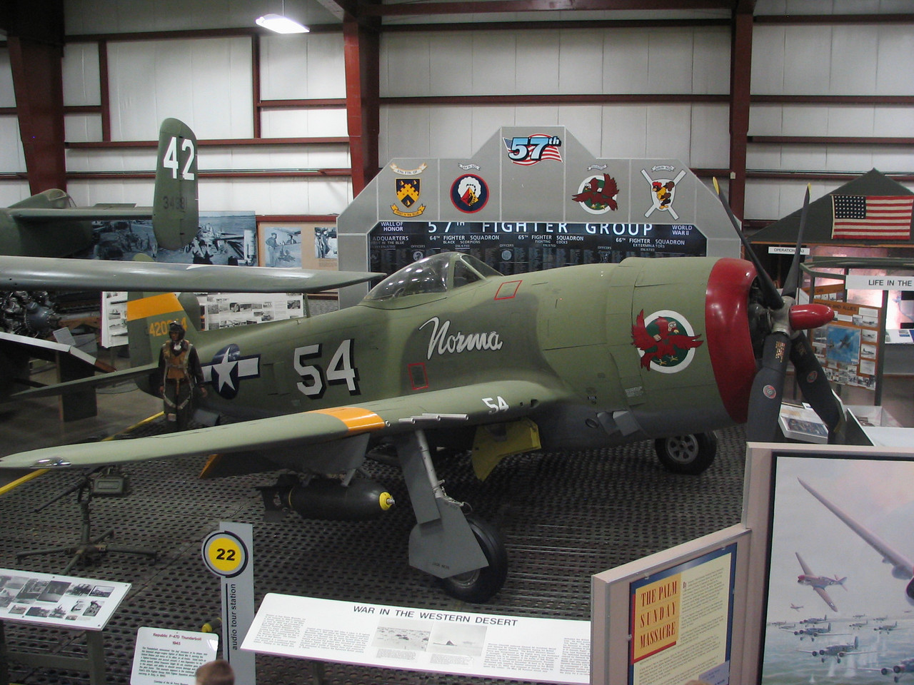 Republic P-47D Thunderbolt 'Norma'. The Thunderbolt was renowned for its ruggedness. It was the heaviest single-engine fighter of WW II and could take a beating from enemy fighters and still return back to base. This particular plane is painted in the markings of the 57th Fighter Group, 65th Fighter Squadron, based at Bradley Field.