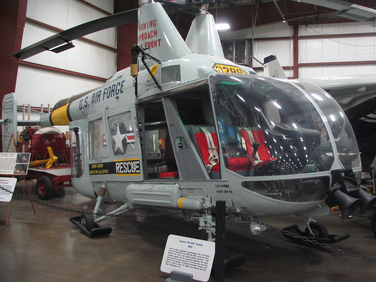 Kaman HH-43F Huskie. This helicopter uses two intermeshing rotors which was a Kaman feature. This particular helicopter was used as an escort to Air Force One flights for Presidents Kennedy, Johnson, and Nixon