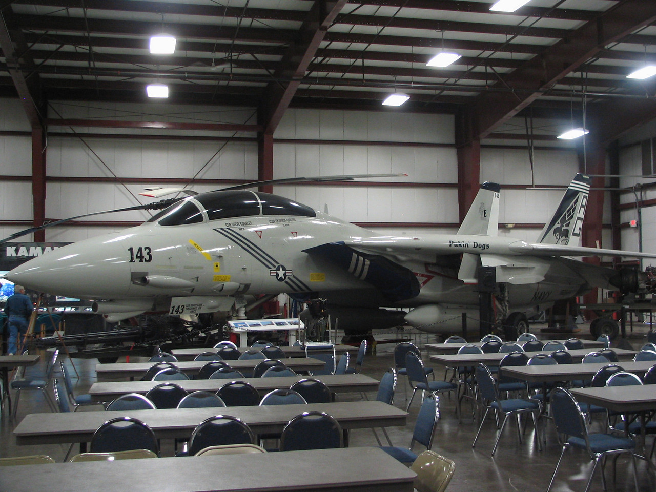 Grumman F-14B Tomcat. Top speed of 1545 mph with two GE turbofan engines producting 23,100lbs of thrust.