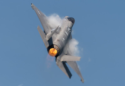 "USAF F-35A ""Lightning"" pulling a high G maneuver in afterburner over the ocean. The humid air condensing on the leading edges of the wing causes some out of focus areas"
