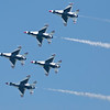 USAF Thunderbirds flying the missing man formation in honor of USMC Capt Jeff Kuss, Blue Angel #6