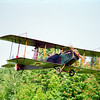 Trudy Trulove tied to the strut of the bad guy's biplane
