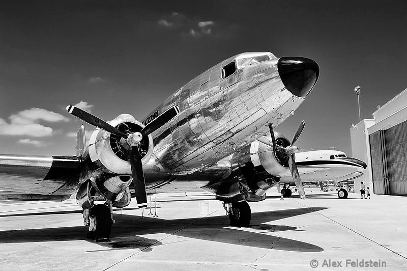 Douglas C-117D (C054, a DC-3 variant) and DC-6 in the back.<br /> Opa-Locka, Florida