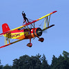 Teresa Stokes waving from the top of Gene Soucy's Grumman Ag Cat bi-plane