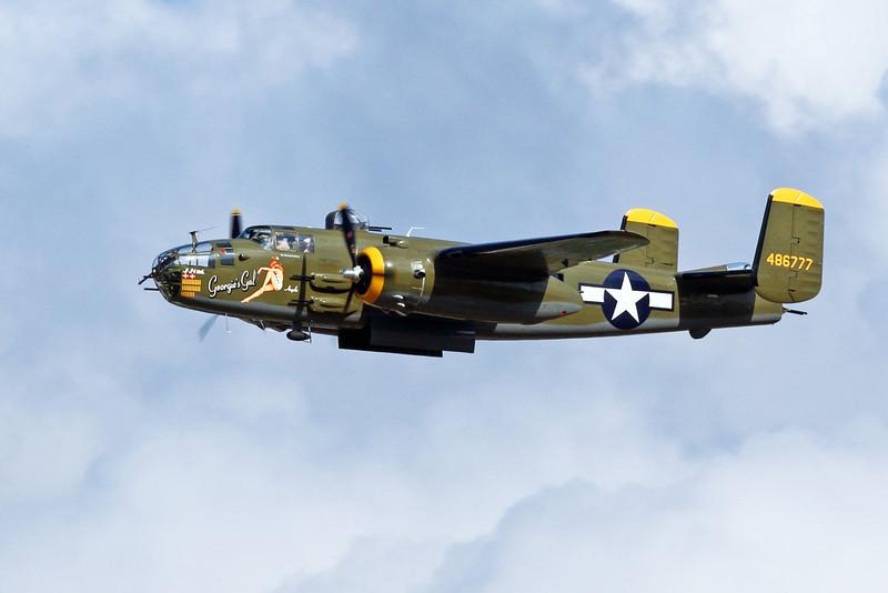 "North American B-25 bomber ""Georgie's Gal"" flying over Oshkosh"