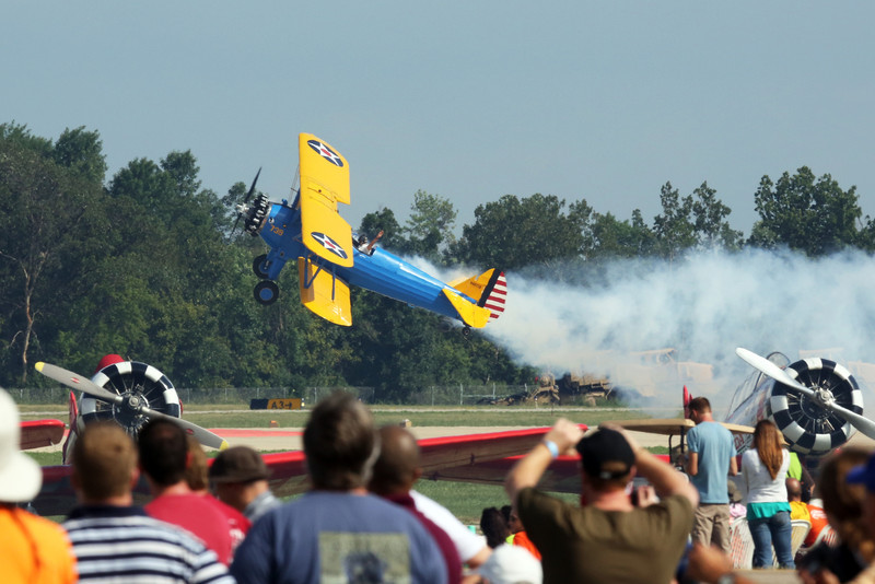 John Mohr in his PT17 waving to the crowd at Oshkosh