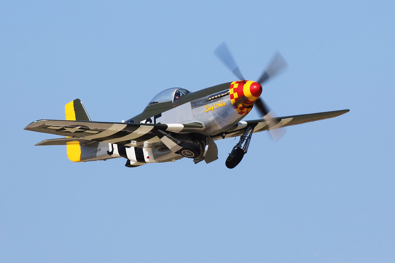"""P51D """"Lady Alice"""" retracting gear after takeoff from Oshkosh."""
