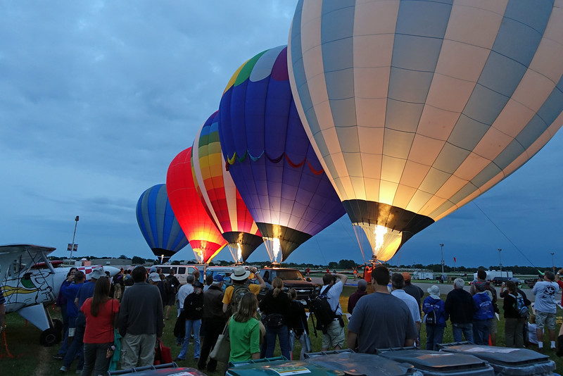 Static hot air balloon demonstration at dusk