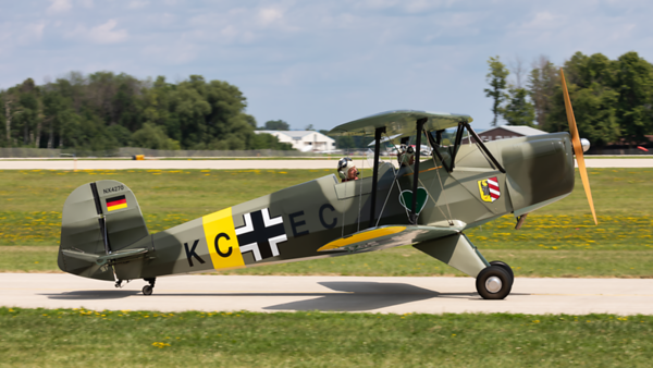 NX4270. Bucker Jungmann CASA 1131 E Luftwaffe. Oshkosh. 230719.
