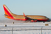 Slowing down on runway 35 and kicking up snow.