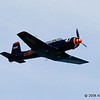 This one passed by at the beach. I have seen it in the local airshow before.<br /> Nanchang CJ-6A.
