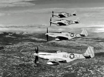 circa 1942:  Four U.S. Army P-51 Mustang fighter airplanes of the 15th Fighter Command fly in formation over the countryside of Italy, during World War II. Its 'teardrop' canopy was developed to provide increased visibility for the pilot.  (Photo by Hulton Archive/Getty Images)