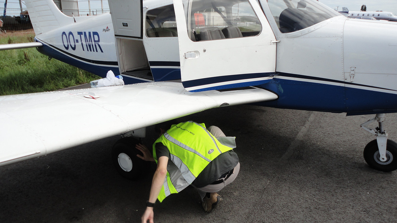Preflight inspection in progress...checking the tyres, wheels and brakes.