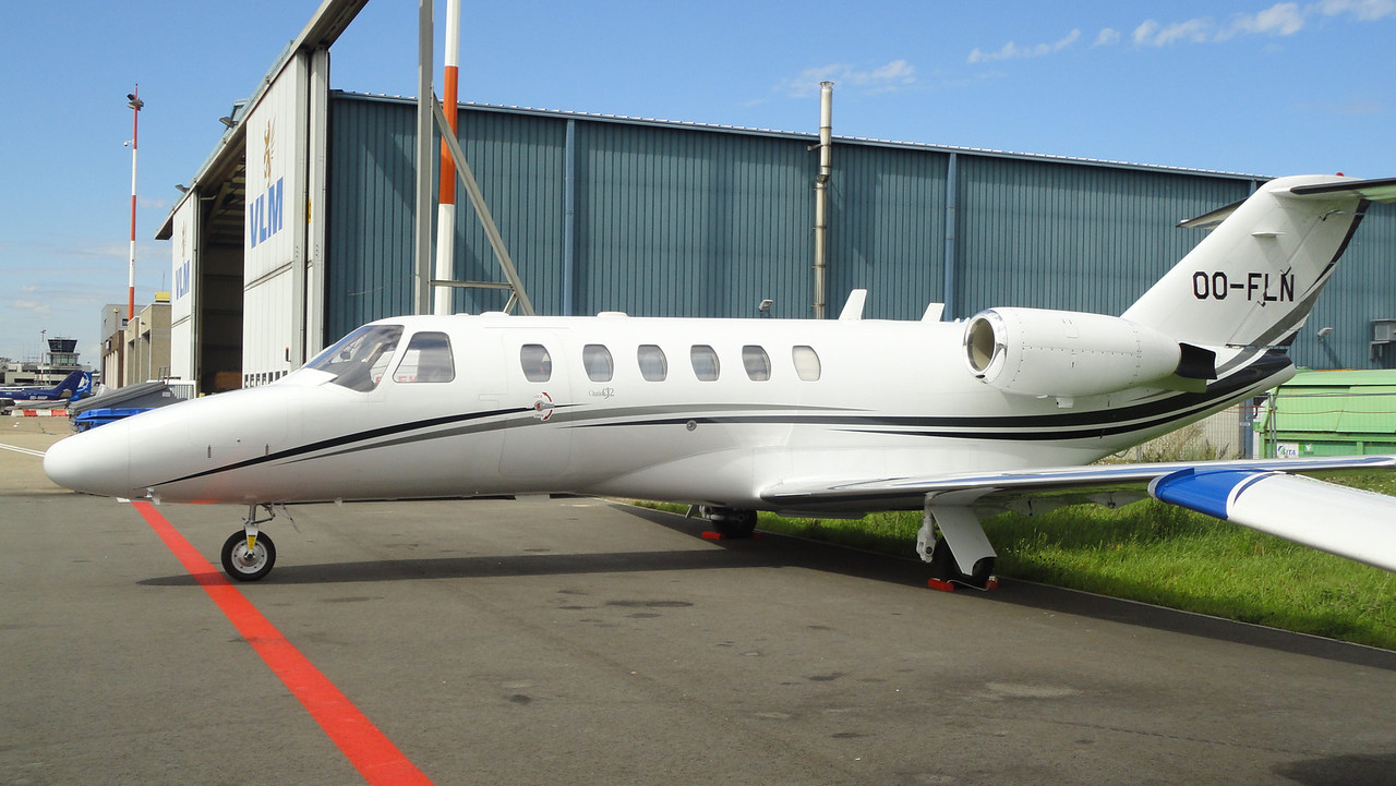 """A common business jet, the Cessna CitationJet CJ2. Also known as the """"Model 525A"""". It's longer than a CJ1. This jet looks very nice in flight, especially it's tapered wings."""