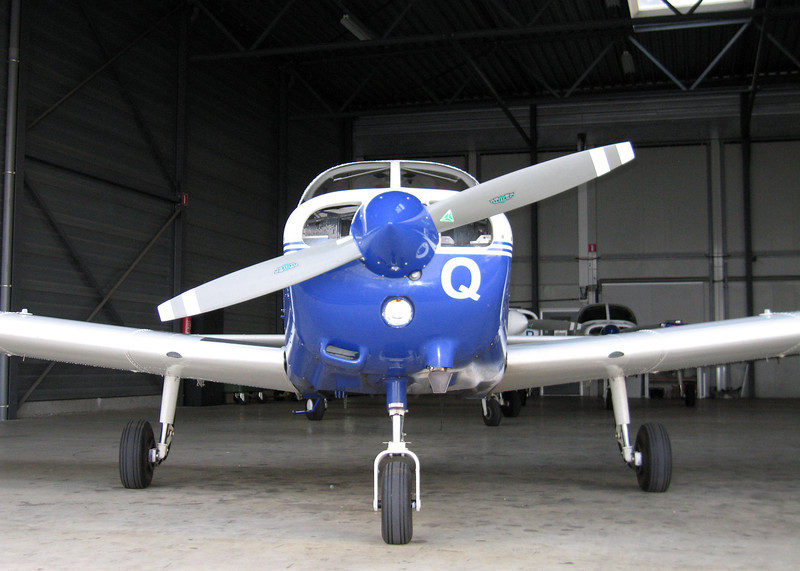 Piper P28A Warrior III. Note the optional silencer for noise reasons.
