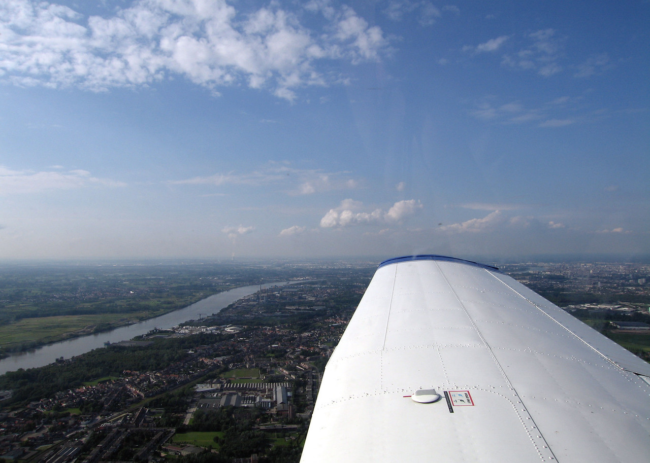 Antwerpen under the wingtip. Schelde river clearly visible.