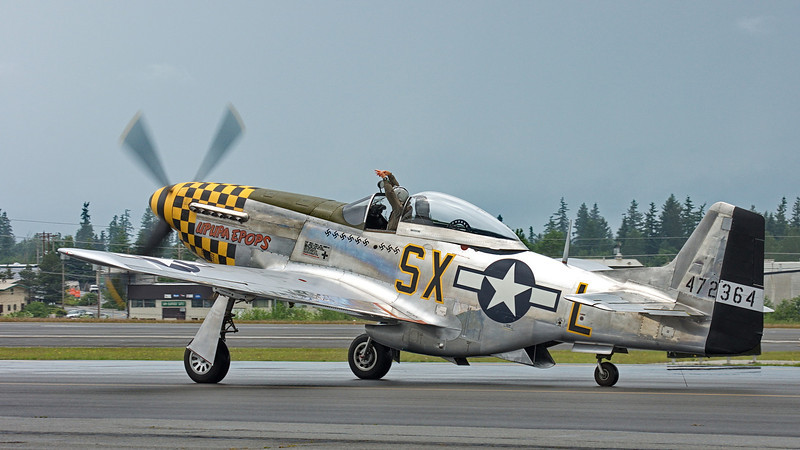 "Bud Granley hamming it up in the P-51D Mustang ""Upapa Epops"""