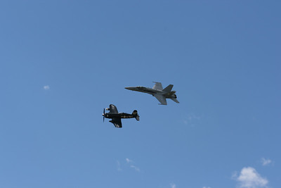 F/A-18 Hornet flying in formation with the WWII/Korea era F4U Corsair.