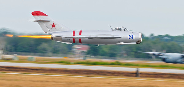 Randy Ball in his Russian MiG17 - F along the runway