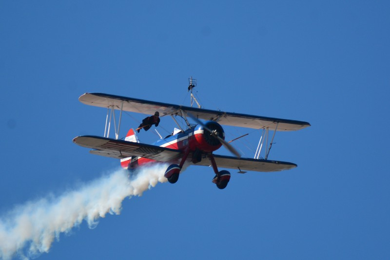 This is the 450 Super Stearman and Wing Walker. Look closely in the next several as she is on the wing and on top of the top of the wing.