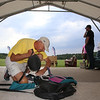 Skydivers over 60 and over 70 attempt to set New England group records, flying out of Skydive Pepperell. Skip Kniley, 72, of Columbus, Ohio, packs his parachute. (SUN/Julia Malakie)