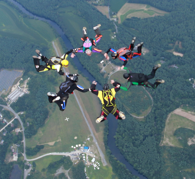 Skydivers Over Seventy in formation over Skydive Pepperell. The airfield is visible at bottom of photo.(Courtesy Photo/Justin Silvia)