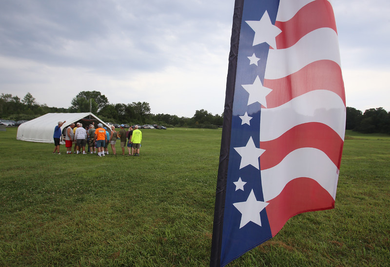 """Skydivers over 60 and over 70 attempt to set New England group records, flying out of Skydive Pepperell. Skydivers Over Sixty do a """"dirt dive"""" to plan their formation. (SUN/Julia Malakie)"""