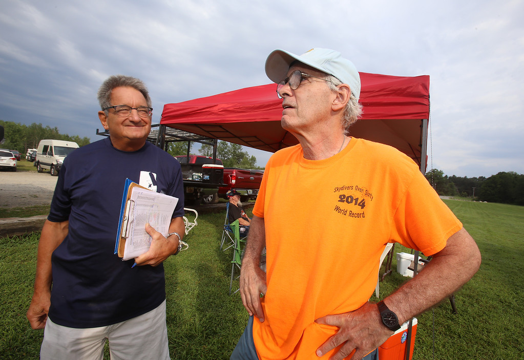 . Skydivers over 60 and over 70 attempt to set New England group records, flying out of Skydive Pepperell. Organizer George Burliss of Hollis, N.H., left, who was not jumping, and Doug Garr of Manhattan. (SUN/Julia Malakie)