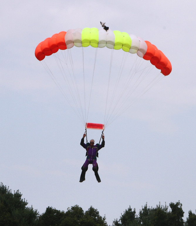 . Skydivers over 60 and over 70 attempt to set New England group records, flying out of Skydive Pepperell. Skip Kniley, 72, of Columbus, Ohio, lands. (SUN/Julia Malakie)