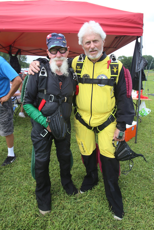 . Skydivers over 60 and over 70 attempt to set New England group records, flying out of Skydive Pepperell. Danny Thompson, 77, of Easton, left, and Bob MacDonald, 78, of Norwell, before the Skydivers Over Seventy jump. (SUN/Julia Malakie)