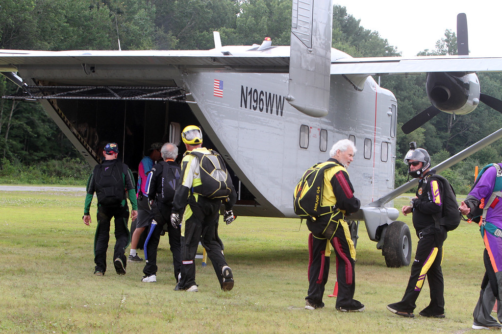 . Skydivers over 60 and over 70 attempt to set New England group records, flying out of Skydive Pepperell. Skydivers Over Seventy board the Skyvan, a rear exit plane that holds 24 people. (SUN/Julia Malakie)