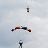 Skydivers over 60 and over 70 attempt to set New England group records, flying out of Skydive Pepperell. Danny Thompson, 77, of Easton, bottom, and Bob MacDonald, 78, of Norwell, top, approach landing. (SUN/Julia Malakie)