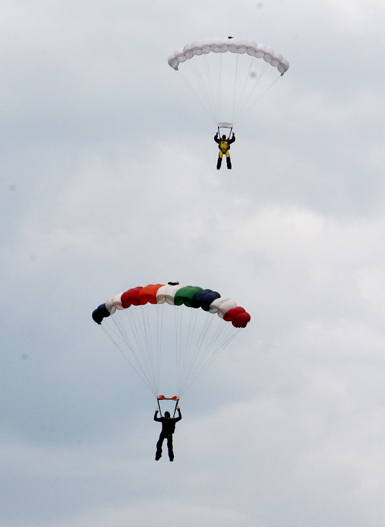 . Skydivers over 60 and over 70 attempt to set New England group records, flying out of Skydive Pepperell. Danny Thompson, 77, of Easton, bottom, and Bob MacDonald, 78, of Norwell, top, approach landing. (SUN/Julia Malakie)