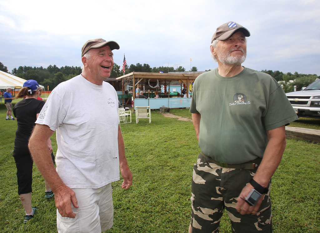 . Skydivers over 60 and over 70 attempt to set New England group records, flying out of Skydive Pepperell. Frederik Winsser, 73, of Ipswich, left, and Bob MacDonald, 78, of Norwell, right. (SUN/Julia Malakie)