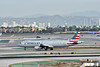 N137AA<br /> American Airlines  Airbus A321 turns off Runway 25L on arrival at LAX with AA2410  from Dallas  (DFW)