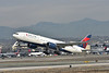 N866DA<br /> Delta Air Lines Boeing 777-232(ER)  lifts off from 25L at LAX with DL7 to Tokyo Haneda (HND)