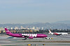TF-GAY<br /> WOW air  Airbus A330-343 is towed towards Tom Bradley Terminal in readiness for departure on WW174 to Reykjavik   (KEF)<br /> as Air China Boeing 777 B-2047 is pushed back from the stands.<br /> <br /> B-2047