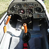 Instruments<br /> Left to right starting top row: G-Meter, Compass, Clock/timer. Bottom row: Airspeed, Ball variometer, Cambridge variometer with multiple sensitivity settings and audio, Altitude. <br /> Center console Top: Radio. Below: system voltage<br /> Right side of cockpit: GPS<br /> <br /> Controls<br /> Left side cockpit, top: Spoilers, bottom: Gear retraction<br /> Center: Airlerons/elevator<br /> Right: Elevator trim, seatback<br /> On center console: Left: (ball)tow release. Right: Rudder adjustment<br /> Top left of panel: lock/unlock for G-meter