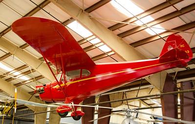 Red single engine plane 6434