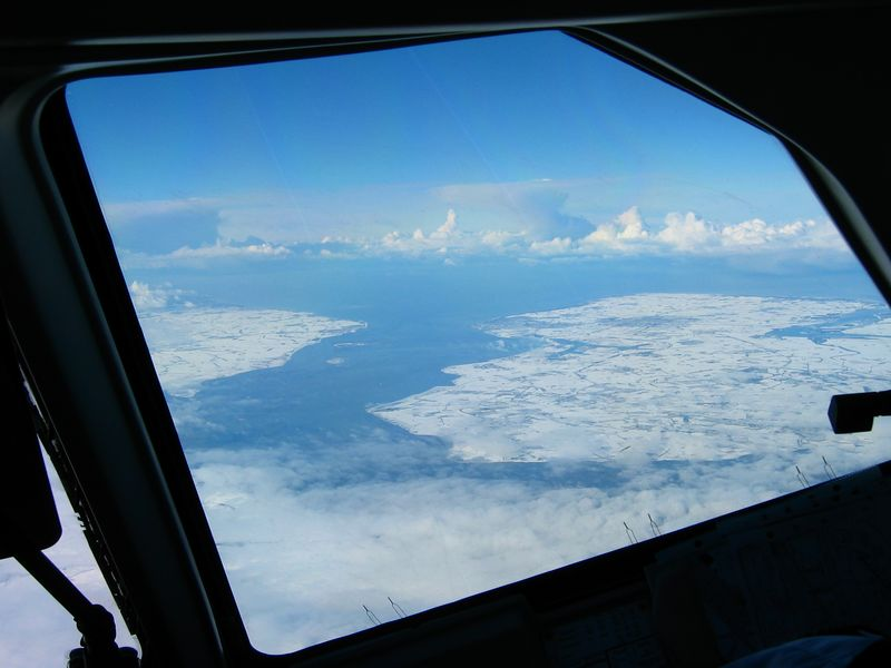 The Westerschelde, connecting Antwerp with the North Sea. Picture taken during climb after take-off from Brussels. Avro RJ, 2004.