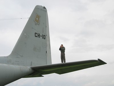 Spotting crewmember on the tail of a Belgian C130.