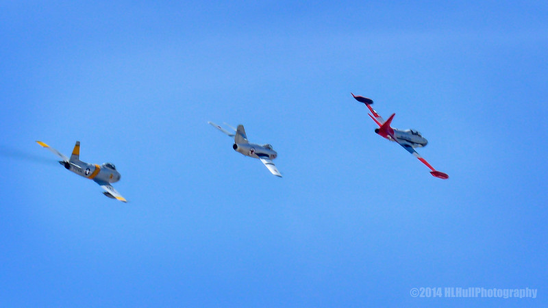 "From L to R:<br /> <br /> North American F-86F Sabre, Mikoyan-Gurevich Mig-15, Lockheed T-33 Shooting Star...<br /> <br /> The North American F-86 Sabre (sometimes called the Sabrejet) was a transonic jet fighter aircraft. Produced by North American Aviation, the Sabre is best known as the United States's first swept wing fighter which could counter the similarly-winged Soviet MiG-15 in high-speed dogfights over the skies of the Korean War. Considered one of the best and most important fighter aircraft in the Korean War, the F-86 is also rated highly in comparison with fighters of other eras. Although it was developed in the late 1940s and was outdated by the end of the 1950s, the Sabre proved versatile and adaptable, and continued as a front-line fighter in numerous air forces until the last active operational examples were retired by the Bolivian Air Force in 1994.  Wikipedia<br /> <br /> The Mikoyan-Gurevich MiG-15 is a jet fighter aircraft developed by Mikoyan-Gurevich OKB for the Soviet Union. Wikipedia<br /> <br /> The Lockheed T-33 Shooting Star is an American jet trainer aircraft. It was produced by Lockheed and made its first flight in 1948 piloted by Tony LeVier. Wikipedia<br /> <br /> Planes of Fame Air Show, May 3-4, 2014<br /> Chino Airport<br /> Chino, CA  <br /> <a href=""http://planesoffame.org/"">http://planesoffame.org/</a><br /> <br /> Thanks for commenting and viewing, much appreciated!<br /> <br /> Critiques welcome...<br /> <br />  17 July 2014"